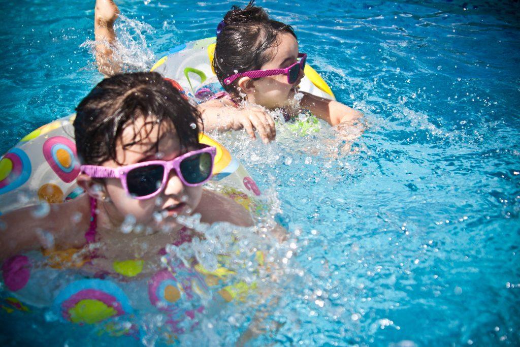 kids having fun in their new swimming pool