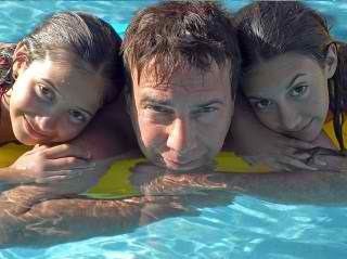 happy family swimming - Austin Custom Pool Builder